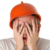 Shocked and surprised builder craftsman isolated on a white back poster