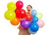 Geschäftsfrau feiert mit bunten Ballons