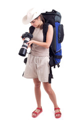 young female tourist with digital camera