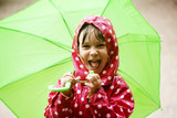 Fototapety Little girl walking in the rain