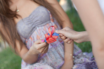 Credit card with a bow in a gift to the young woman. Low depth o