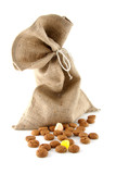 jute bag with ginger nuts over white background