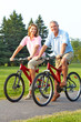 seniors couple biking