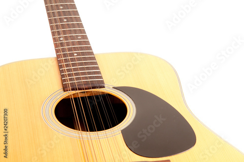 a 12 string acoustic guitar isolated on white