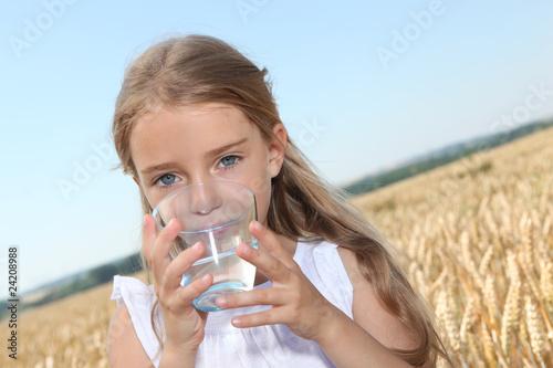 Closeup of little blonde girl drinking wtaer - 24208988
