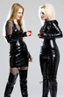 women in latex with handcuffs