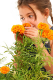 Girl Smelling Marigold