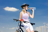 biker with bottle of water
