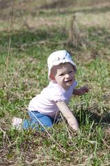 little girl kneeling on meadow