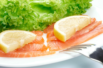 Salted salmon on white plate.