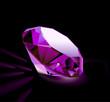 single pink diamond on black background