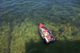 Rowing boat in shallow water, Asurias, Spain