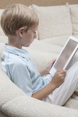 Boy reads a digital book