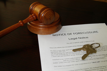 foreclosure document with house keys and court gavel