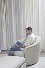 Man sits reading a digital book