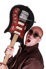 Bald guy with guitar shout
