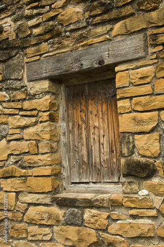 Stone wall with closed wood  window