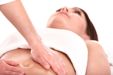 Young woman having stomach massage.