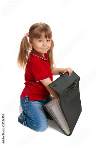 Little girl with a case on white