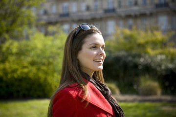 Portrait of a young woman outdoors, smiling