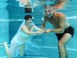 Ringtausch mit der Braut unter Wasser