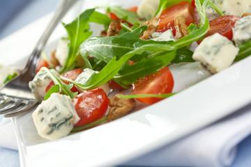 Salad with gorgonzola,arugula,tomatoes and walnuts