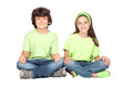Couple of children with same clothes sitting