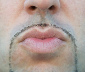Close up of a man lips sending a kiss.