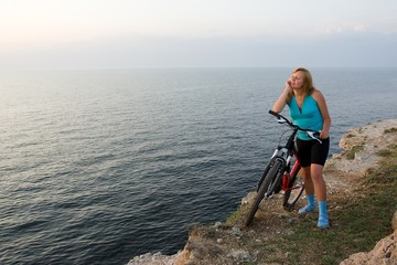 Girl with bike and sea.