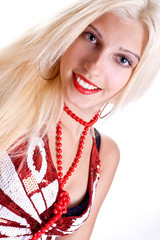 woman in shirt with red beads