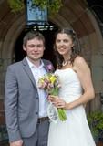 Bride and Groom closeup at church door poster