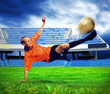Happiness football player after goal on the field of stadium und