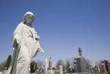 Statue And Headstones ; Laval, Quebec, Canada poster