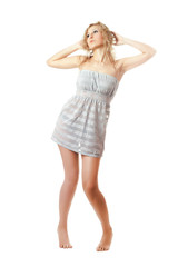 Attractive blonde in a nightie barefoot