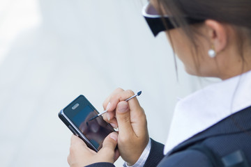 business woman looking for data on their mobile