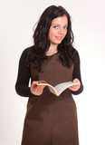 Brunette with apron and book poster