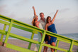 two beautiful women and man on California beach coast