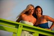 two beautiful women on California beach coast
