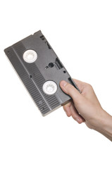 Hand with video cassette isolated over white
