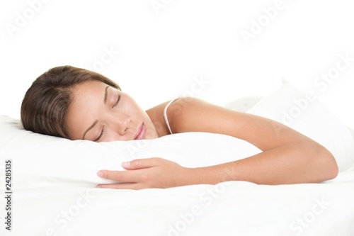 Leinwanddruck Bild Woman sleeping on white background