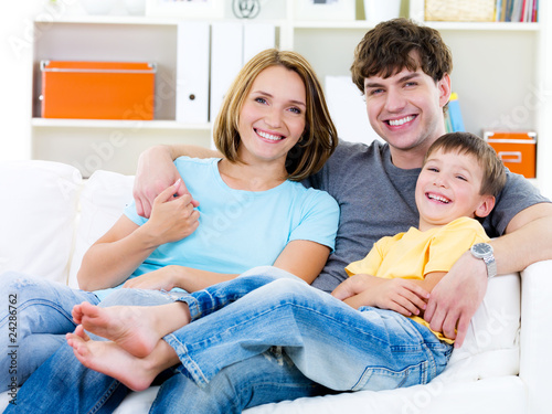 Happy family with son on the sofa