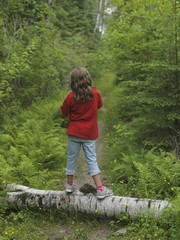 Young Girl Standing On Log,Lake Of The Woods,Ontario,Canada