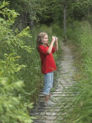 Young Girl Taking A Picture,Lake Of The Woods,Ontario,Canada
