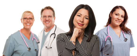 Hispanic Woman with Male and Female Doctor or Nurse