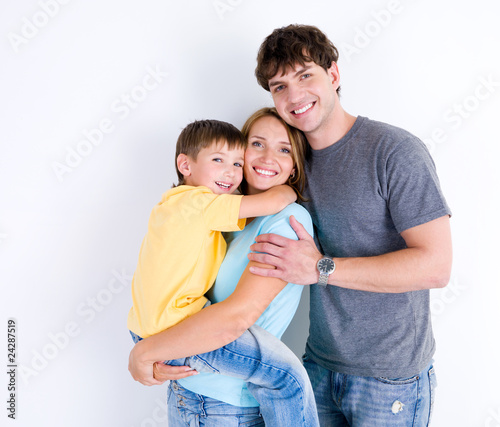 Happy family in embrace with little son