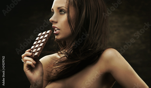 Gorgeous woman holding chocolate