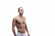 Young sexy man is wearing white towel