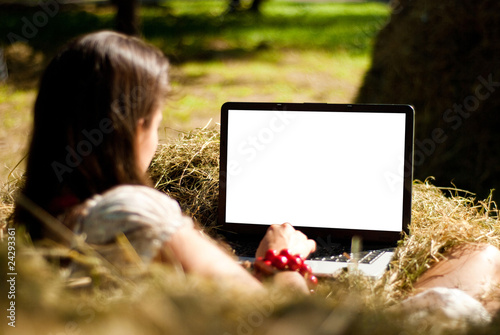Beauty on a farm with laptop.