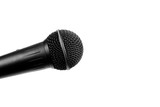 A black microphone isolated on white