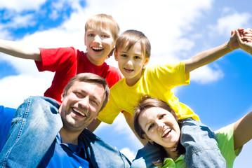 happy boys with parents